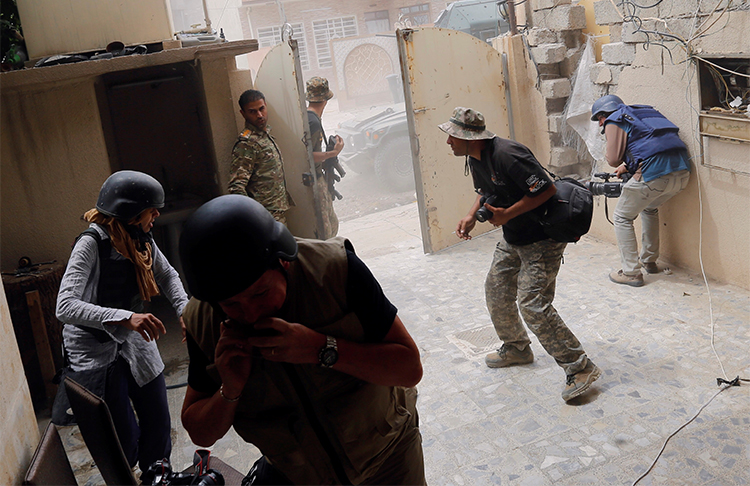 Photographers take cover during clashes between Iraqi forces and Islamic State militants in Mosul in May 2017. Journalists covering the fighting are advised to take safety precautions. (Reuters/Danish Siddiqui)