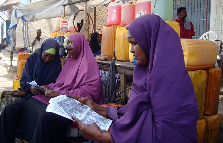 Women read newspapers in a Mogadishu market in 2010. Somali authorities are proposing changes to the country's media law, that include new restrictions for the press. (Reuters/Feisal Omar)