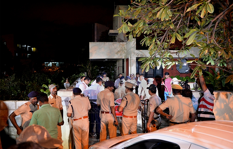 The Home Minister of Karnataka state and police gather outside the Bangalore house where journalist Gauri Lankesh was shot dead on September 5. (AFP/Manjunath Kiran)