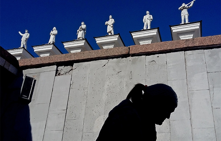 A woman walks in front of the palace of culture in Karaganda, Kazakhstan, in April 2017. A Kazakh court has banned an editor from working for three years. (AFP/Kirill Kudryavtsev)
