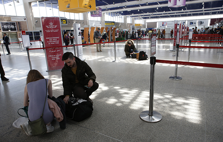 Passengers store their electronic items in their suitcases and bags when arriving at the Casablanca Mohammed V International Airport on Thursday, March 29, 2017. Moroccan authorities detained British reporter Saeed Kamali Dehghan on September 27, and then expelled him from Morocco. (AP/ Abdeljalil Bounhar)