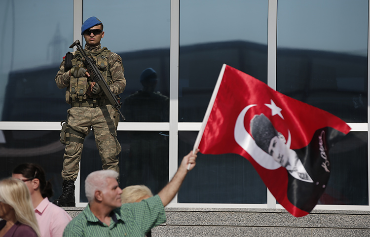 Protesters in Silivri, Turkey demonstrate in support of journalists and staff from the Cumhuriyet newspaper who Turkish officials have accused of aiding terror organizations. Their trial is part of a larger media crackdown under President Recep Tayyip Erdoğan. (AP Photo/Emrah Gurel)