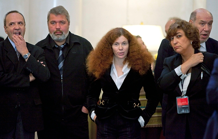 Russian journalist Yulia Latynina, pictured center in 2009 with other Novaya Gazeta journalists, is in hiding after a series of attacks on her home. (AP/Alexander Zemlianichenko)