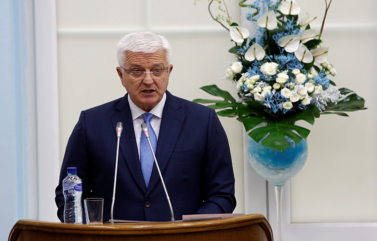Montenegro's Prime Minister Dusko Markovic addresses the parliament during a discussion on NATO membership agreement in Cetinje, Montenegro on April 28. During a telephone conversation on Monday, a man believed to be Markovic's brother threatened a local reporter. (Reuters/Stevo Vasiljevic)