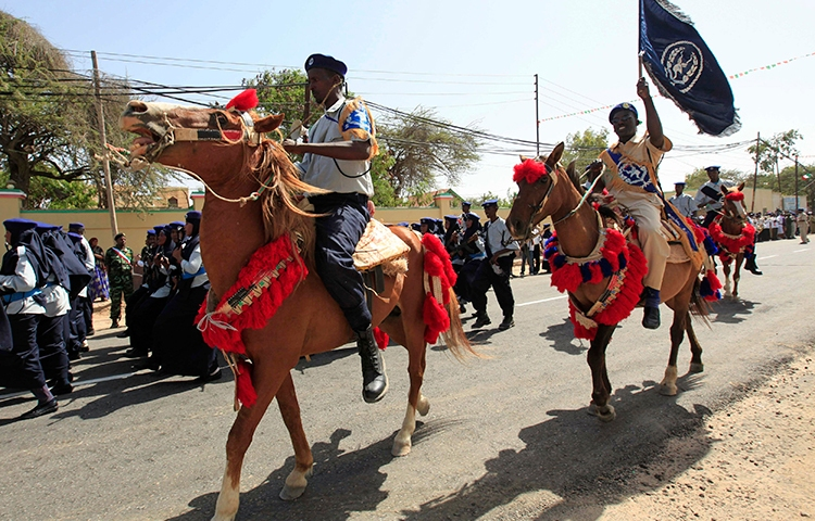Somaliland police ride horses during independence celebrations in Hargeisa in 2013. Authorities in the region are detaining a journalist on false news accusations. (Reuters/Feisal Omar)