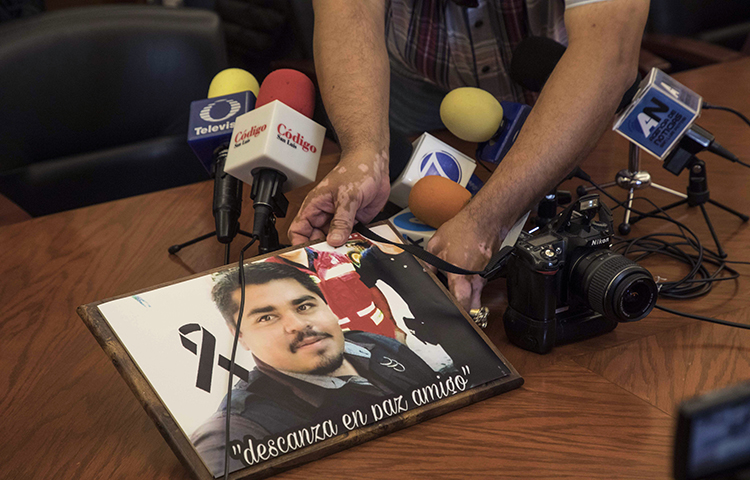 An image of slain Mexican journalist Edgar Daniel Esqueda Castro is shown during a protest before the start of a press conference at the State House in San Luis Potosi, Mexico on Friday, Oct. 6, 2017. Mexican authorities on Friday found Esqueda Castro's body in San Luis Potosi one day after armed men wearing uniforms abducted him from his home, authorities said. (AP/Christian Palma)