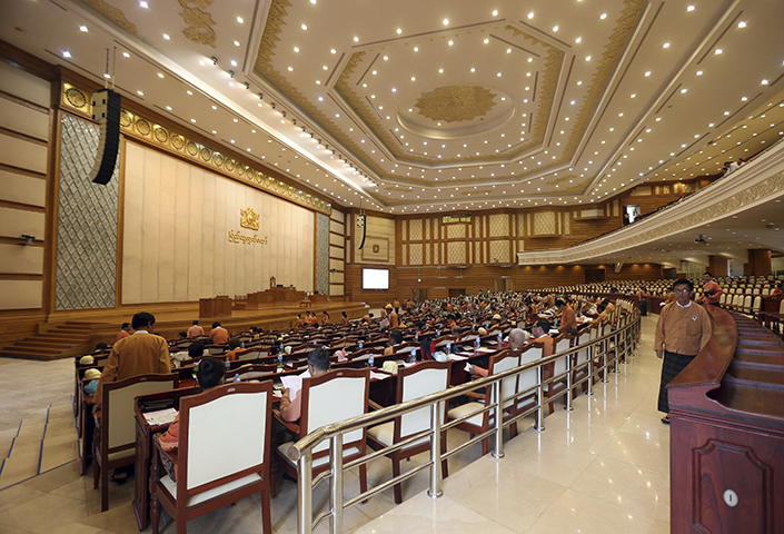 Lawmakers attend a regular session of the lower house of parliament in Naypyitaw, Myanmar on Monday, June 19, 2017. Myanmar authorities on October 27 detained two foreign reporters, along with their interpreter and driver, after the journalists flew a drone near the country's parliament building. (AP/Aung Shine Oo)