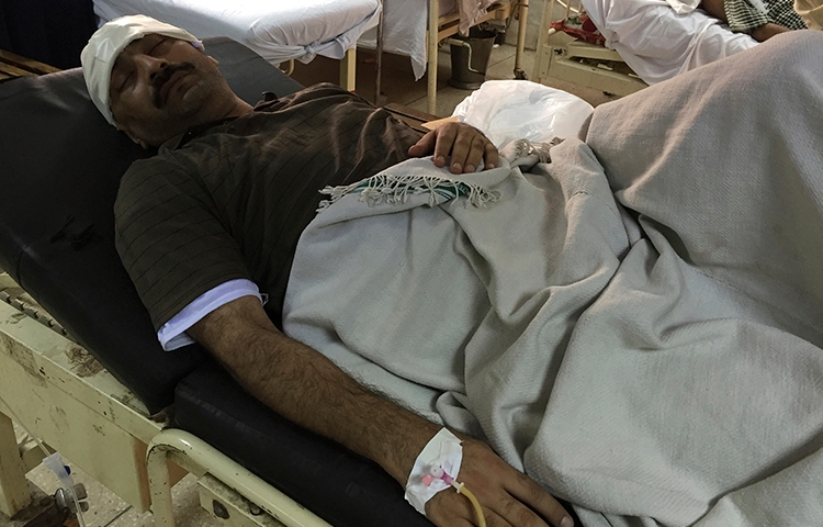 Pakistani investigative reporter Ahmed Noorani lies in a hospital bed in Islamabad, Pakistan, on October 27, 2017. Assailants on motorcycles attacked the outspoken Pakistani journalist in the capital, Islamabad, leaving him badly injured. (AP/B.K. Bangash)