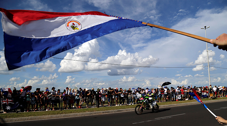 A Paraguay flag is waved during the 2017 Dakar rally in Asuncion. A draft law in Paraguay is proposing strict social media regulations. (Reuters/Jorge Adorno)