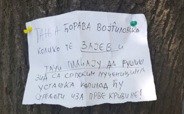 A death threat, pictured, directed at Tatjana Vojtehovski and full of derogatory terms, was pinned to a tree in a place visible to the critical journalist. (Tatjana Vojtehovski)