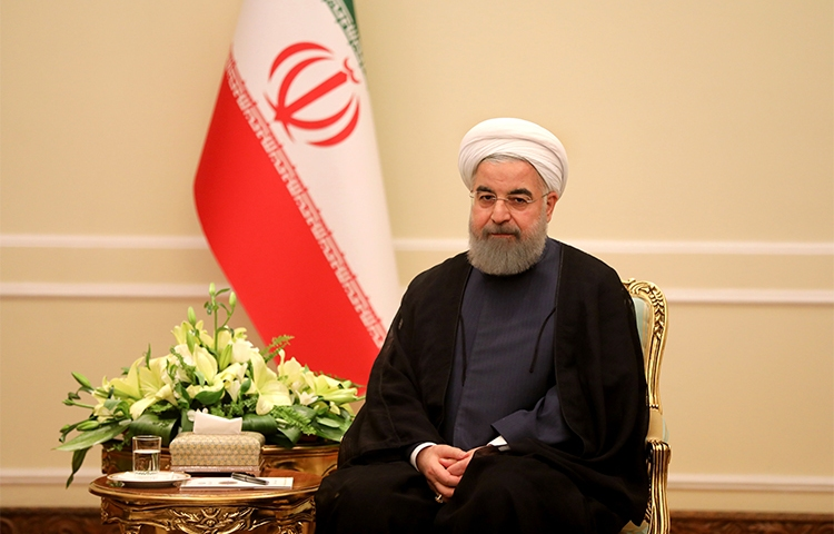 President Rouhani, pictured in Tehran on November 6. The U.N. is due to vote next week on a resolution to promote human rights in Iran. (AFP/Atta Kenare)