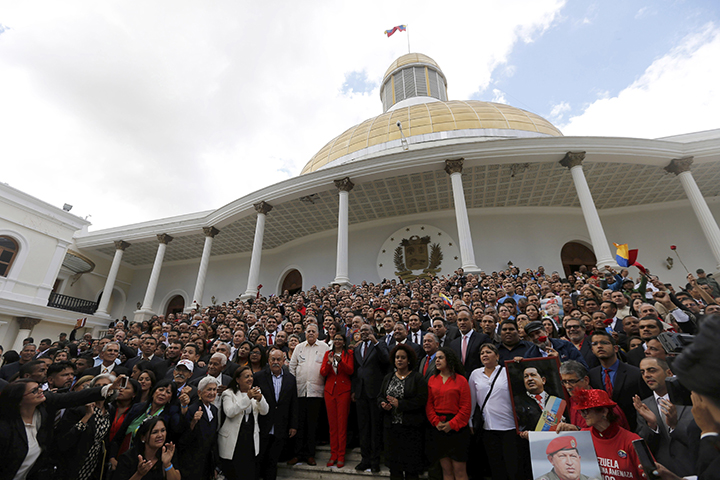 Venezuela's constituent assembly poses for an official photo after being sworn in, at the National Assembly in Caracas, Venezuela on August 4, 2017. The assembly passed a wide-reaching law on November 8 that clamps down on social media and broadcasters alike. (AP/Ariana Cubillos)