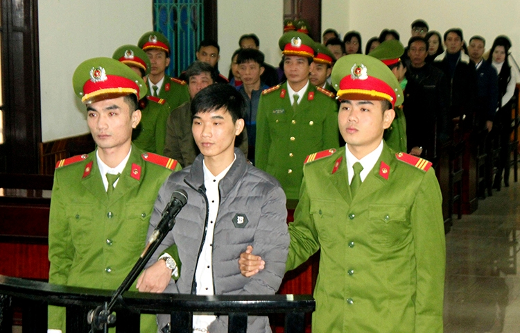 Nguyen Van Hoa, center, was sentenced to seven years in prison on November 27, 2017, after being convicted of spreading anti-state propaganda. (Cong Tuong/Vietnam News Agency/AP)