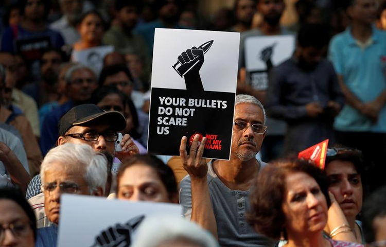 People in New Delhi protest the killing of journalists in India in September. An investigative journalist was shot dead on November 21 in Tripura state. (Reuters/Cathal McNaughton)