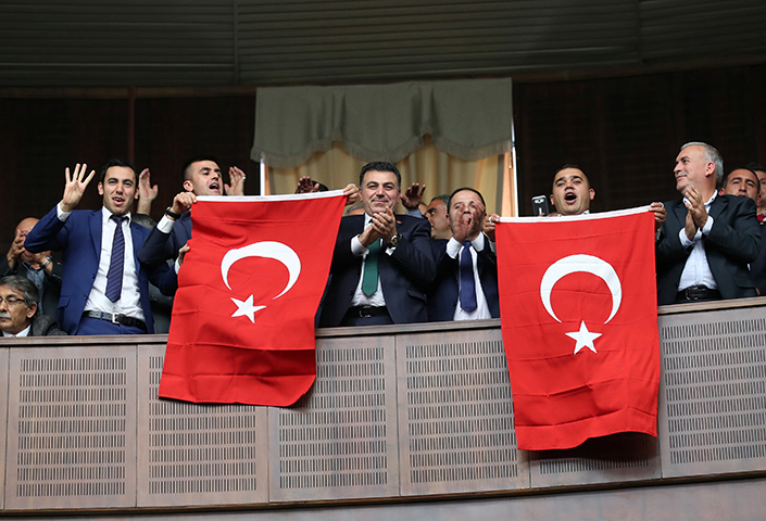 Supporters of Turkish President Recep Tayyip Erdogan cheer as he addresses parliament in Ankara, Turkey, November 7, 2017. Turkish authorities, under Erdogan's leadership, began a wide-reaching crackdown after a failed attempted coup in June 2016. (Reuters/Umit Bektas)