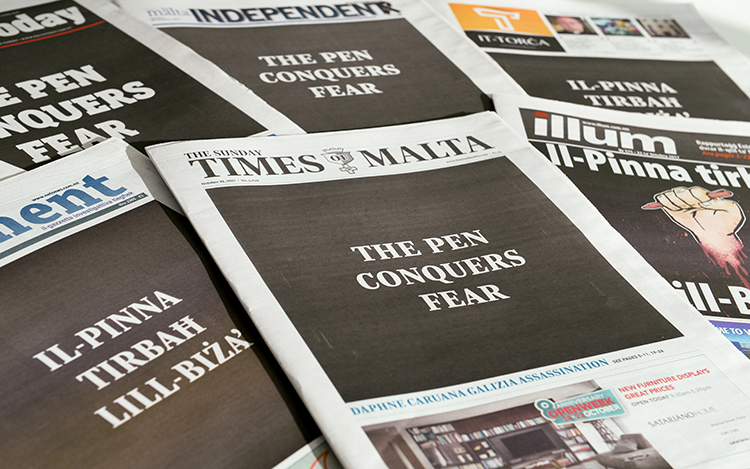 In a show of unity following the murder of Maltese blogger Daphne Caruana Galizia, the country's newspapers carry the slogan 'The Pen Conquers Fear' on October 22. (AFP/Matthew Mirabelli)