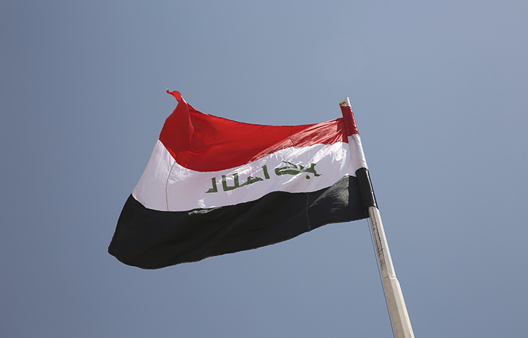 An Iraqi flag on August 30, 2017. Al-Anbar authorities on November 17, 2017, ordered a television station to close its regional offices on the grounds that they violated Iraqi licensing agreements. (AP/Sam McNeil)