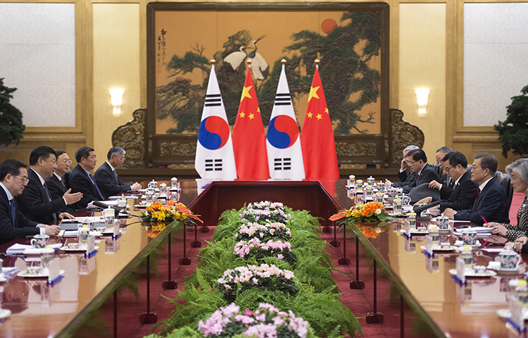 South Korean President Moon Jae-in, second right, and Chinese President Xi Jinping, second left, meet during a bilateral meeting at the Great Hall of the People in Beijing, Thursday, Dec. 14, 2017. (Nicolas Asfouri/Pool/AP)