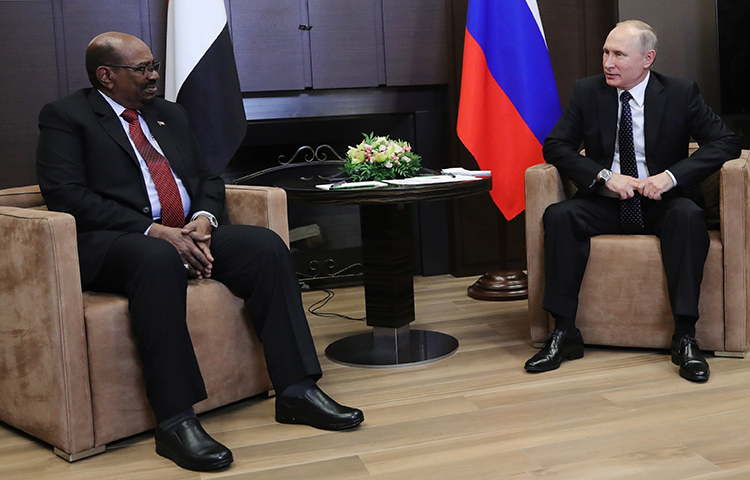 Russian President Vladimir Putin, right, talks to Sudanese President Omar al-Bashir during their meeting in Russia's Black Sea resort of Sochi, on Thursday, Nov. 23, 2017. Sudanese authorities began confiscating all copies of four opposition newspapers after they reported critically on this meeting. (AP/Kremlin Pool/Mikhail Klimentyev)