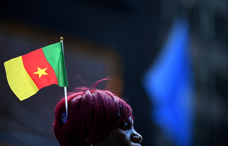 A supporter of President Paul Biya waits outside a Manhattan hotel during the UN General Assembly in September. Cameroonian authorities detained a columnist in Douala on December 6 for allegedly offending the president. (Reuters/Darren Ornitz)