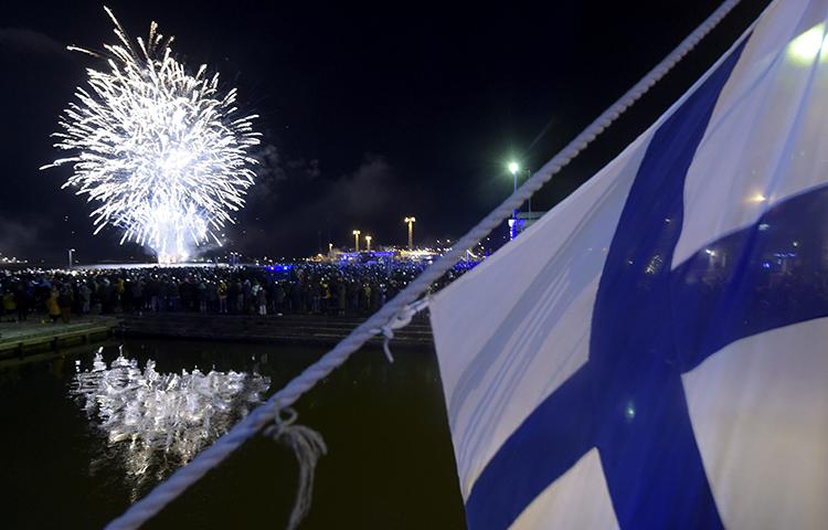 Fireworks illuminate the sky to end the festivities of the centenary of Finnish independence in Helsinki, Finland on December 6, 2017. Finnish police searched the Helsinki home of journalist Laura Halminen on December 17, 2017. (Lehtikuva/ Vesa Moilanen/ Reuters)