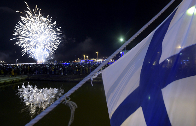 Fireworks illuminate the sky to end the festivities of the centenary of Finnish independence in Helsinki, Finland on December 6, 2017. Finnish police searched the Helsinki home of journalist Laura Halminen on December 17, 2017. (Lehtikuva/ Vesa Moilanen/ Reuters)