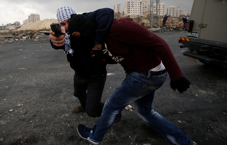 Undercover Israeli security personnel detain a Palestinian demonstrator during clashes at a protest against U.S. President Donald Trump's decision to recognize Jerusalem as the capital of Israel, near the Jewish settlement of Beit El, near the West Bank city of Ramallah December 13, 2017. (Reuters/Mohamad Torokman)