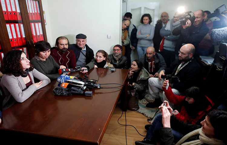 Mesale Tolu holds a news conference at her lawyer's office in Istanbul, Turkey, December 18, 2017. Tolu, who worked in Turkey as a translator for the socialist Etkin News Agency (ETHA), was released pending trial, the German news agency Deutsche Welle reported. (Reuters/Osman Orsal)