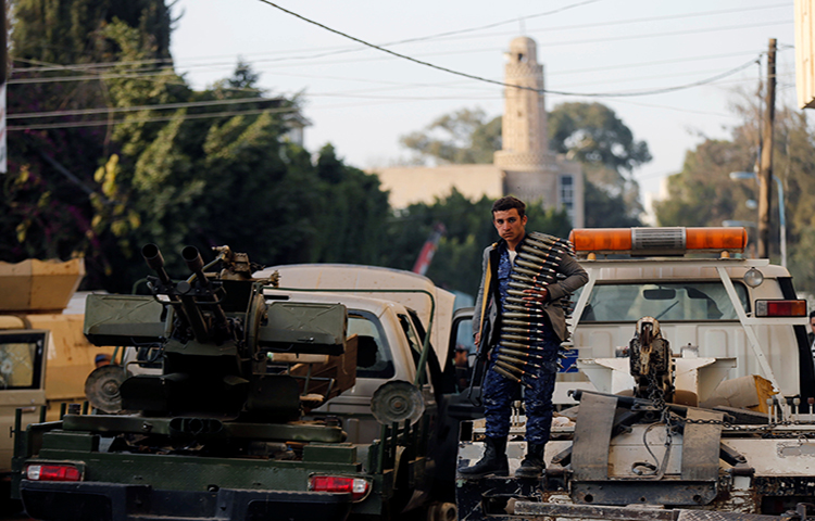 A Houthi fighter stands on a truck outside the house of Yemen's former president Ali Abdullah Saleh after Saleh was killed, in Sanaa, Yemen December 4, 2017. (Reuters/Khaled Abdullah)