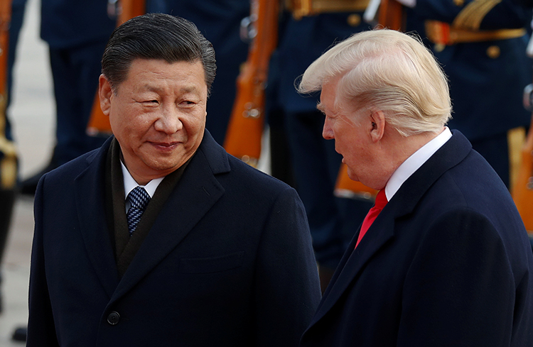 Presidents Xi Jinping and Donald Trump take part in a welcoming ceremony during a visit to Beijing in November 2017. China is jailing 41 journalists. (Reuters/Damir Sagolj)
