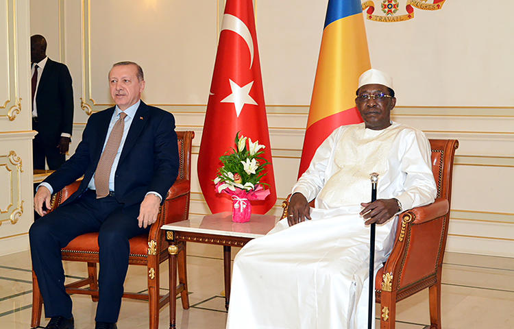 Turkish President Recep Tayyip Erdogan (L) and Chad's President Idriss Deby (R) pose for photographs at the presidential palace ahead of a meeting, in N'Djamena, on December 26, 2017. Journalist Mahamat Abakhar Issa wrote a satirical piece, published on December 27, 2017, outlining a conversation between Sudanese President Omar al-Bashir and Erdoğan in which Chad is characterized as unstable and unworthy of investment. (AFP/Brahim Adji)