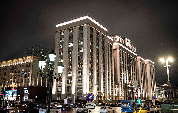 Cars drive in front of the building housing Russia's State Duma. The lower house voted in January to approve a bill that will require some journalists to register as foreign agents. (AFP/Mladen Antonov)