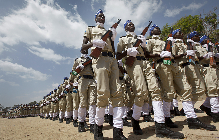 Somali police parade at a ceremony to mark the 74th anniversary of the formation of the police force, at the police academy in the capital Mogadishu, Somalia Wednesday, Dec. 20, 2017. (AP/Farah Abdi Warsameh)