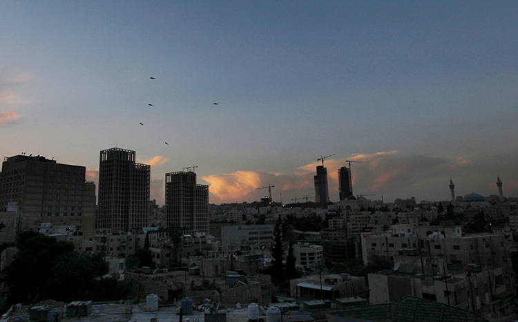 A sunset over Amman in 2012. Two Jordanian journalists are facing charges in the city over their reporting. (AP/Mohammad Hannon)