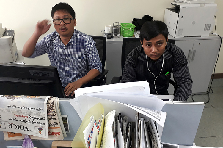 Reuters journalists Wa Lone, left, and Kyaw Soe Oo, face up to 14 years in prison for their reporting in Myanmar. (Reuters/Antoni Slodkowski)