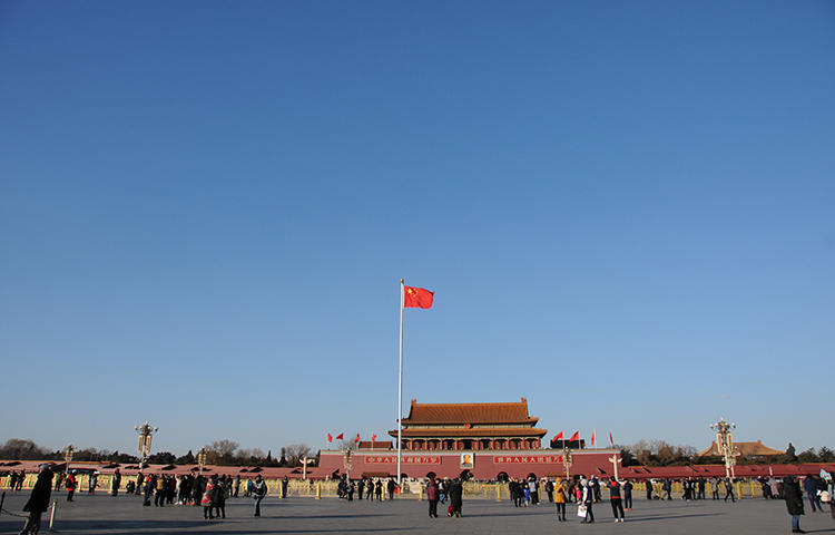 A Chinese flag flutters against blue sky in Tiananmen Square in Beijing, China in December 2017. The Foreign Correspondents' Club of China annual survey, released this week, showed a steady deterioration of working conditions in China for the foreign press. (Reuters/Stringer)