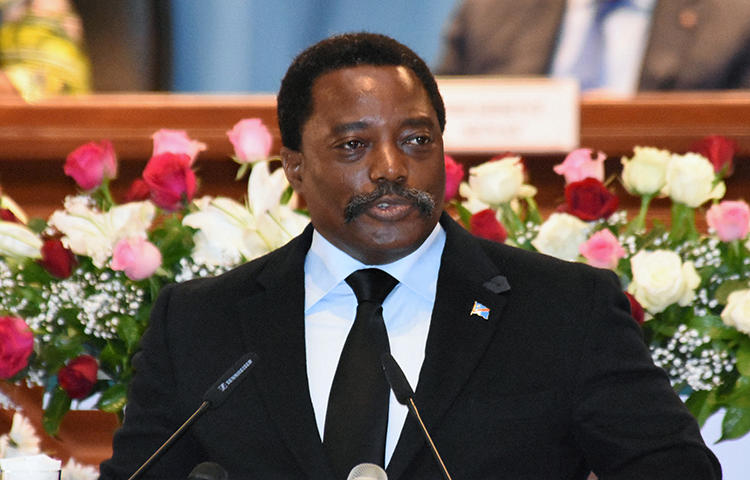 Democratic Republic of Congo's President Joseph Kabila addresses the nation at Palais du Peuple in the capital Kinshasa in April 2017. Agents from the Congolese military intelligence services accused journalist Willy Akonda of taking photographs that