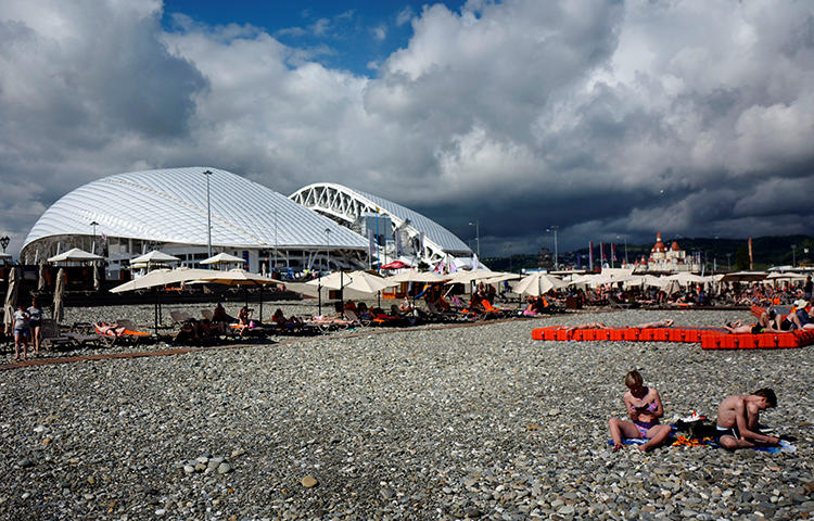 People enjoy a sunny day just outside the Fisht stadium, at the sea front in Sochi, Russia in June 2017. A Sochi court charged local blogger Aleksandr Valov with extorting money from the city's federal parliamentary deputy. (Reuters/Kai Pfaffenbach)