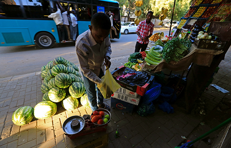 A street vendor waits for customers in Khartoum, Sudan on December 2, 2016. Akhbar al-Watan's editor, Hanady al-Siddiq, told journalists in a written statement that the government's recent confiscation of critical newspapers is likely related to the newspapers' coverage of rising food prices in the country. (Reuters/Mohamed Nureldin Abdallah)