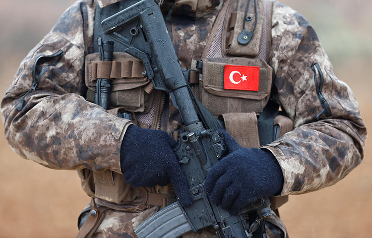 Turkish police special forces stand guard in Azaz, Syria on January 24, 2018. Prime Minister Binali Yıldırım asked journalists to frame Turkey's military incursions into northern Syria as an operation to protect the civilian population from terrorists, according to the online newspaper Odaty. (Reuters/Osman Orsal)