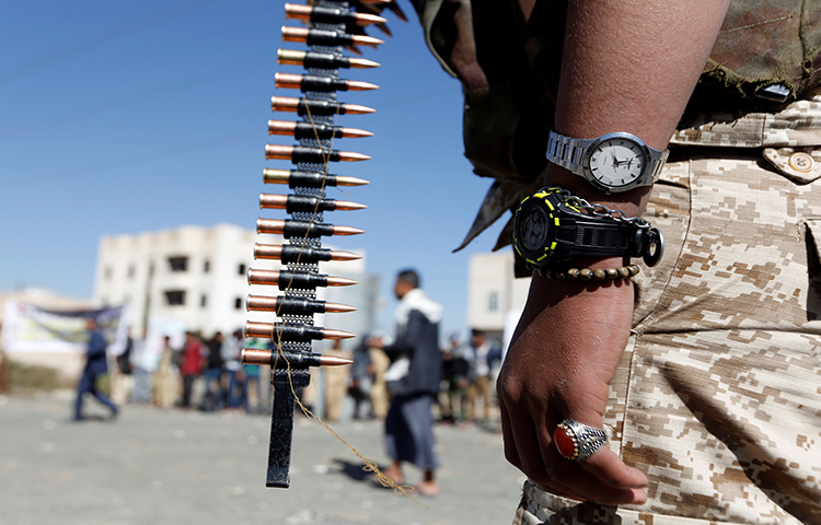 A Houthi militant takes part in a parade held to mark 1,000 days of the Saudi-led military intervention in the Yemeni conflict, in Sanaa, Yemen on December 19, 2017. (Reuters/Khaled Abdullah)