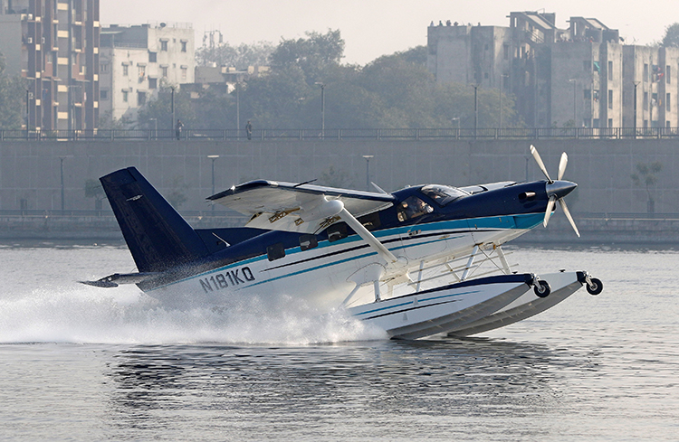 A sea-plane takes off in Ahmedabad in December. A journalist says Dalit activists in the city attacked and threatened her when she tried to interview a patient. (Reuters/ Amit Dave)