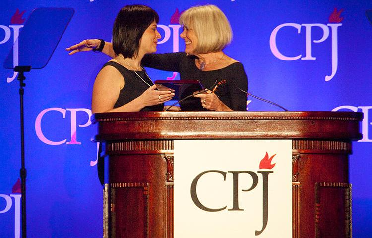 Belarusian journalist Natalya Radina, left, receives the 2011 International Press Freedom Award from Anne Garrels. Belarus has blocked access to Radina's news website, Charter 97. (Getty Images/AFP/Michael Nagle)