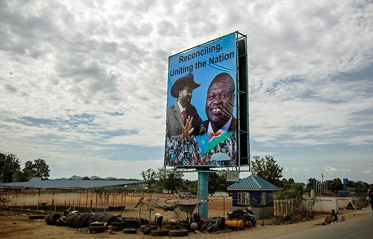 A billboard featuring President Salva Kiir, left, and opposition leader Riek Machar, is displayed in Juba in 2016. South Sudan is due to resume peace talks under an agreement that includes calls for an end to harassment of the press. (AFP/Albert Gonzalez Farran, CDS)