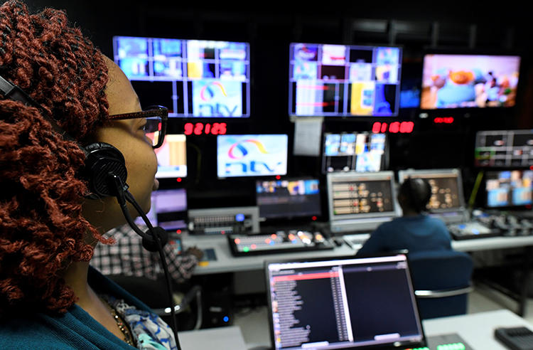 NTV employees in the station's Nairobi studio on January 19. Kenya is ignoring a court order suspending a broadcasting ban on NTV and three other stations. (AFP/Simon Maina)
