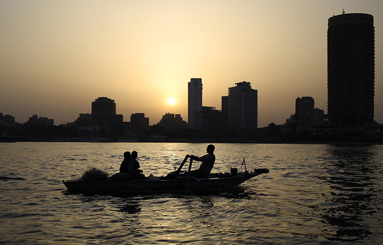 Egyptian fishermen on the Nile River as the sun sets in Cairo, Egypt, in April 2015. Ahead of presidential elections scheduled between March 26 and 28, 2018, the Egyptian government has been keen to silence any critical reporting, CPJ research shows. (AP/Hassan Ammar)