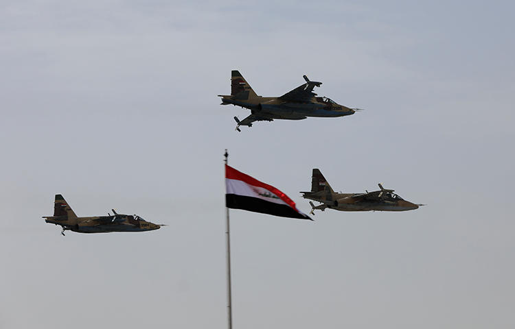 Iraqi Air Force planes fly past during Iraqi Army Day anniversary celebrations in Baghdad, Iraq on January 6, 2018. Men who identified themselves as Iraqi security forces arrested a journalist on the outskirts of Baghdad on February 2, according to reports. (Reuters/Thaier Al-Sudani)