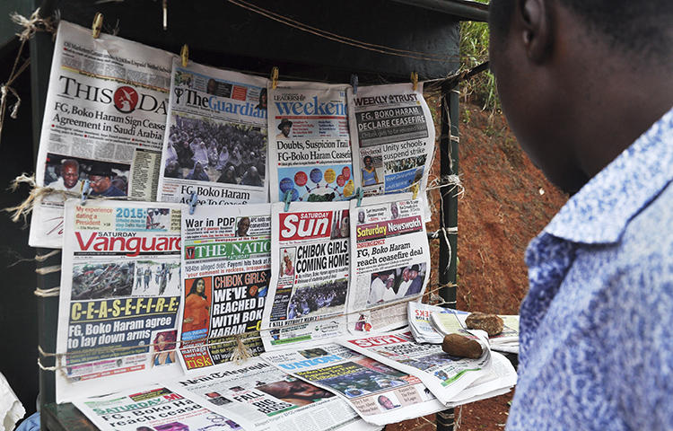 A news stand in Abuja, Nigeria in October 2014. A Nigerian court is scheduled to arraign brothers Timothy and Daniel Elombah, editor and chief executive respectively, of the independent Elombah news website, on cybercrime and terrorism-related offenses on March 1, 2018.(Reuters/ Stringer)