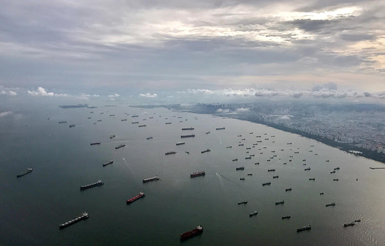 A bird's-eye view of ships along the coast in Singapore in July 2017. Singapore's parliament is considering draft legislation that would prevent journalists from reporting on what was happening terror attacks.(Reuters/Jorge Silva)