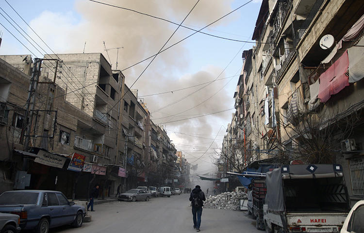 Smoke from an air raid rises in the besieged town of Douma, Eastern Ghouta, Damascus, Syria on February 23, 2018. Abdul Rahman Ismael Yassin, a reporter for the pro-opposition Hammouriyeh Media Office, died from injuries sustained in a February 20 airstrike in eastern Ghouta, according to reports. (Reuters/Bassam Khabieh)